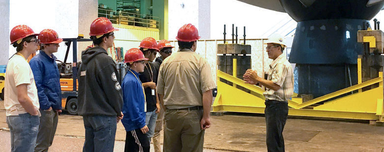 students touring facility