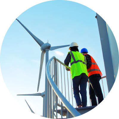 Two workers near wind turbines