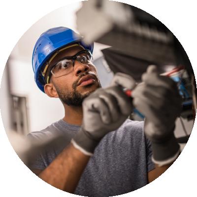 Worker adjusts machine