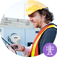 Man uses tablet near electrical meter